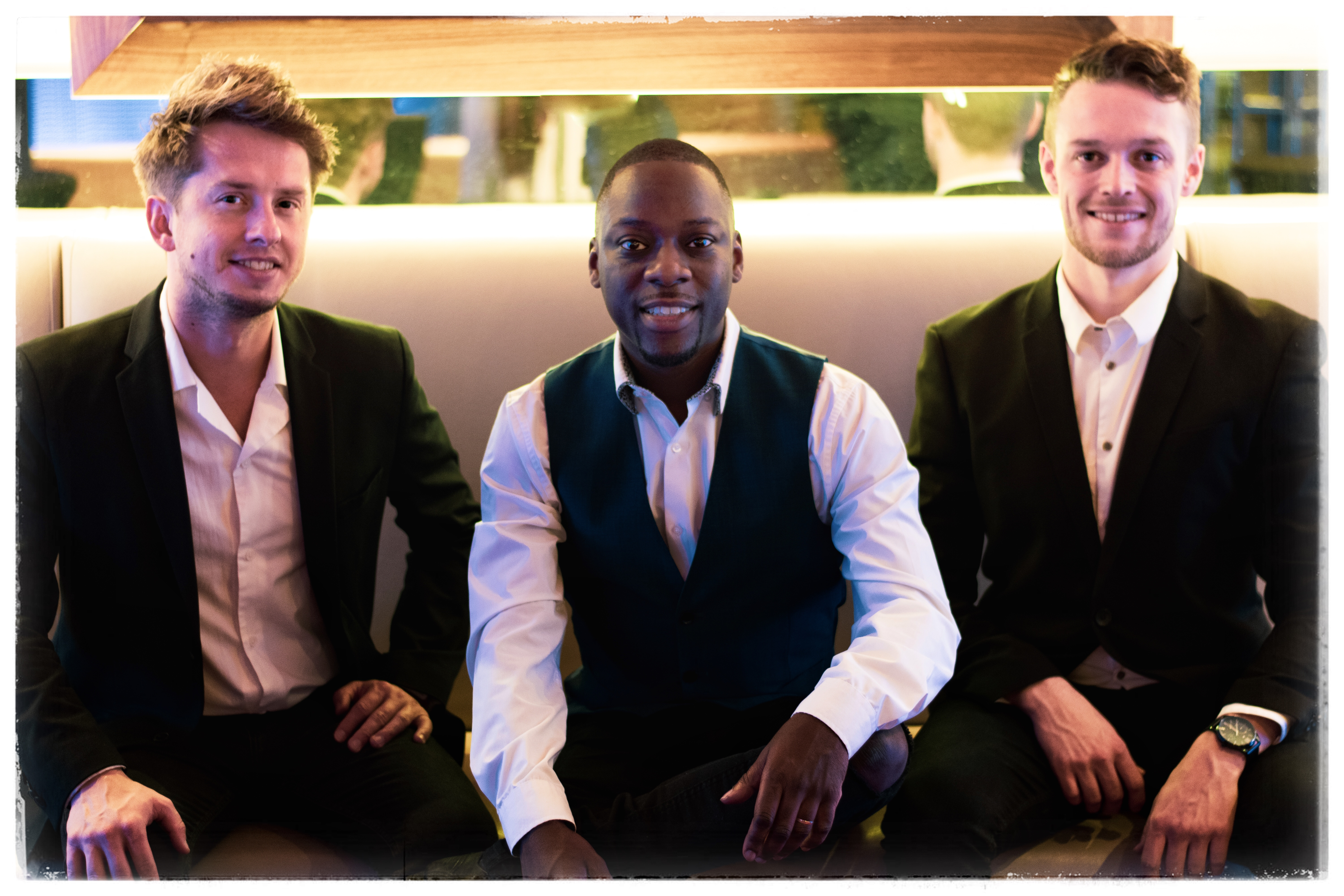 the piano singer trio sitting at a gig